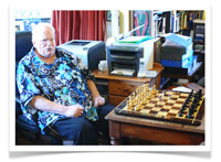 Patrick Moore with his Regeny Chess Set, customised by King Edward's School, Bath.